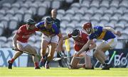 20 July 2021; Cork players Sam Quirke, left, and Ethan Twomey battle for possession against Tipperary players Kian O'Kelly, left, and Sean Hayes during the Munster GAA Hurling U20 Championship semi-final match between Tipperary and Cork at Semple Stadium in Thurles, Tipperary. Photo by Ben McShane/Sportsfile