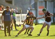 20 July 2021; Jack Morrissey of Kilkenny in action against Evan Duggan of Galway watched by Kilkenny manager Derek Lyng during the Leinster GAA Hurling U20 Championship semi-final match between Kilkenny and Galway at Bord Na Mona O'Connor Park in Tullamore, Offaly. Photo by David Fitzgerald/Sportsfile