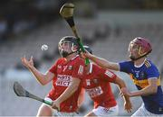 20 July 2021; Daniel Hogan of Cork in action against Kieth Ryan of Tipperary during the Munster GAA Hurling U20 Championship semi-final match between Tipperary and Cork at Semple Stadium in Thurles, Tipperary. Photo by Ben McShane/Sportsfile