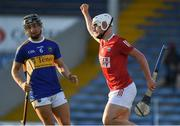 20 July 2021; Robbie Cotter of Cork celebrates after scoring his side's second goal as Kevin Maher of Tipperary looks on during the Munster GAA Hurling U20 Championship semi-final match between Tipperary and Cork at Semple Stadium in Thurles, Tipperary. Photo by Ben McShane/Sportsfile