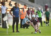 20 July 2021; Kilkenny manager Derek Lyng looks on as Sean McDonagh of Galway takes a sideline cut during the Leinster GAA Hurling U20 Championship semi-final match between Kilkenny and Galway at Bord Na Mona O'Connor Park in Tullamore, Offaly. Photo by David Fitzgerald/Sportsfile