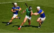 18 July 2021; Gearoid Hegarty of Limerick in action against David Reidy, left, and Diarmaid Byrnes of Limerick during the Munster GAA Hurling Senior Championship Final match between Limerick and Tipperary at Páirc Uí Chaoimh in Cork. Photo by Ray McManus/Sportsfile