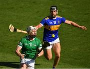 18 July 2021; Cian Lynch of Limerick and Dan McCormack of Tipperary during the Munster GAA Hurling Senior Championship Final match between Limerick and Tipperary at Páirc Uí Chaoimh in Cork. Photo by Ray McManus/Sportsfile