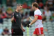 11 July 2021; Derry manager Rory Gallagher and Padraig Cassidy, right, before the Ulster GAA Football Senior Championship Quarter-Final match between Derry and Donegal at Páirc MacCumhaill in Ballybofey, Donegal. Photo by Stephen McCarthy/Sportsfile