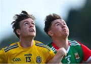 21 July 2021; Ben O'Carroll of Roscommon and Ruairí Keane of Mayo watch the dropping ball during the EirGrid Connacht GAA Football U20 Championship Final match between Mayo and Roscommon at Elverys MacHale Park in Castlebar, Mayo. Photo by Piaras Ó Mídheach/Sportsfile