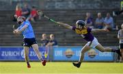 21 July 2021; Diarmuid Ó Dúlaing of Dublin in action against Cian Ó Tuama of Wexford during the Electric Ireland Leinster GAA Minor Hurling Championship Semi-Final match between Dublin and Wexford at Chadwicks Wexford Park in Wexford. Photo by Daire Brennan/Sportsfile