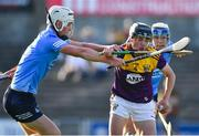 21 July 2021; Robbie Chapman of Wexford in action against Leon Kennedy of Dublin during the Electric Ireland Leinster GAA Minor Hurling Championship Semi-Final match between Dublin and Wexford at Chadwicks Wexford Park in Wexford. Photo by Daire Brennan/Sportsfile