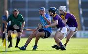 21 July 2021; Ben Gaughran of Dublin in action against Cian Ó Tuama, left, and Cillian Byrne of Wexford during the Electric Ireland Leinster GAA Minor Hurling Championship Semi-Final match between Dublin and Wexford at Chadwicks Wexford Park in Wexford. Photo by Daire Brennan/Sportsfile