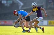 21 July 2021; Dennis McSweeney of Dublin in action against Seán Cooney of Wexford during the Electric Ireland Leinster GAA Minor Hurling Championship Semi-Final match between Dublin and Wexford at Chadwicks Wexford Park in Wexford. Photo by Daire Brennan/Sportsfile