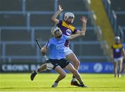21 July 2021; Conal Ó Riain of Dublin in action against Seán Cooney of Wexford during the Electric Ireland Leinster GAA Minor Hurling Championship Semi-Final match between Dublin and Wexford at Chadwicks Wexford Park in Wexford. Photo by Daire Brennan/Sportsfile