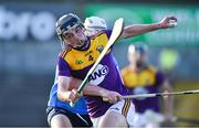 21 July 2021; Robbie Chapman of Wexford in action against Conn Rock of Dublin during the Electric Ireland Leinster GAA Minor Hurling Championship Semi-Final match between Dublin and Wexford at Chadwicks Wexford Park in Wexford. Photo by Daire Brennan/Sportsfile