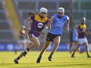 21 July 2021; Cillian Byrne of Wexford in action against David Lucey of Dublin during the Electric Ireland Leinster GAA Minor Hurling Championship Semi-Final match between Dublin and Wexford at Chadwicks Wexford Park in Wexford. Photo by Daire Brennan/Sportsfile