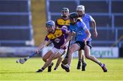 21 July 2021; Luke Murphy of Wexford in action against Eoin Keys of Dublin during the Electric Ireland Leinster GAA Minor Hurling Championship Semi-Final match between Dublin and Wexford at Chadwicks Wexford Park in Wexford. Photo by Daire Brennan/Sportsfile