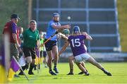 21 July 2021; Ben Gaughran of Dublin in action against Fionn Walsh, left, and Luke Murphy of Wexford during the Electric Ireland Leinster GAA Minor Hurling Championship Semi-Final match between Dublin and Wexford at Chadwicks Wexford Park in Wexford. Photo by Daire Brennan/Sportsfile