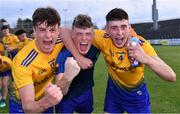 21 July 2021; Roscommon players, from left, Ben O'Carroll, Shane Keenan, and Dylan Gaughan celebrate after his their side's victory in the EirGrid Connacht GAA Football U20 Championship Final match between Mayo and Roscommon at Elverys MacHale Park in Castlebar, Mayo. Photo by Piaras Ó Mídheach/Sportsfile