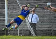 21 July 2021; Roscommon captain Colin Walsh, right, palms the ball off the goal line, supported by his goalkeeper Conor Carroll in injury time of the second half during the EirGrid Connacht GAA Football U20 Championship Final match between Mayo and Roscommon at Elverys MacHale Park in Castlebar, Mayo. Photo by Piaras Ó Mídheach/Sportsfile