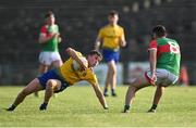21 July 2021; Daire Cregg of Roscommon in action against Conor Dunleavy of Mayo during the EirGrid Connacht GAA Football U20 Championship Final match between Mayo and Roscommon at Elverys MacHale Park in Castlebar, Mayo. Photo by Piaras Ó Mídheach/Sportsfile