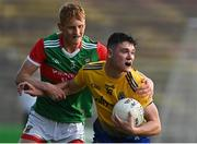 21 July 2021; Jason Doory of Roscommon in action against Jack Carney of Mayo during the EirGrid Connacht GAA Football U20 Championship Final match between Mayo and Roscommon at Elverys MacHale Park in Castlebar, Mayo. Photo by Piaras Ó Mídheach/Sportsfile