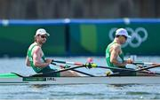 24 July 2021; Ronan Byrne, left, and Philip Doyle of Ireland cross the finish line in 3rd place during the Men's Double Sculls repechage at the Sea Forest Waterway during the 2020 Tokyo Summer Olympic Games in Tokyo, Japan. Photo by Seb Daly/Sportsfile