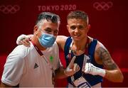 24 July 2021; Kurt Walker of Ireland and coach John Conlan following his Men's Featherweight round of 32 bout with Jose Quiles Brotons of Spain at the Kokugikan Arena during the 2020 Tokyo Summer Olympic Games in Tokyo, Japan. Photo by Stephen McCarthy/Sportsfile