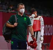 24 July 2021; Jack Woolley of Ireland leaves the arena behind Robert Taaffe, high performance director of the Irish Taekwondo Union, after defeat to Lucas Lautaro Guzman of Argentina in the men's -58Kg taekwondo round of 16 at the Makuhari Messe Hall during the 2020 Tokyo Summer Olympic Games in Tokyo, Japan. Photo by Brendan Moran/Sportsfile