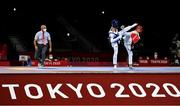 24 July 2021; Jack Woolley of Ireland in action against Lucas Guzman of Argentina during the men's -58Kg taekwondo round of 16 at the Makuhari Messe Hall during the 2020 Tokyo Summer Olympic Games in Tokyo, Japan. Photo by Brendan Moran/Sportsfile