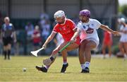 24 July 2021; Kate Wall of Cork in action against Nicole Malcolmson of Kildare during the All Ireland Intermediate Camogie Championship match between Kildare and Cork at Manguard Plus Kildare GAA Centre of Excellence in Newbridge, Kildare. Photo by Daire Brennan/Sportsfile