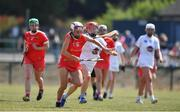 24 July 2021; Katie Walsh of Cork in action against Maria Doyle of Kildare during the All Ireland Intermediate Camogie Championship match between Kildare and Cork at Manguard Plus Kildare GAA Centre of Excellence in Newbridge, Kildare. Photo by Daire Brennan/Sportsfile