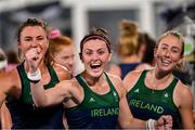24 July 2021; Ireland players, from left, Deirdre Duke, Roisin Upton, Sarah Hawkshaw celebrate following victory in the Women's Pool A Group Stage match between Ireland and South Africa at the Oi Hockey Stadium during the 2020 Tokyo Summer Olympic Games in Tokyo, Japan. Photo by Ramsey Cardy/Sportsfile