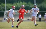 24 July 2021; Katie Walsh of Cork in action against Maria Doyle, left, and Siobhán Hurley of Kildare during the All Ireland Intermediate Camogie Championship match between Kildare and Cork at Manguard Plus Kildare GAA Centre of Excellence in Newbridge, Kildare. Photo by Daire Brennan/Sportsfile