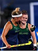 24 July 2021; Ireland players Lena Tice, left, and Roisin Upton celebrate following victory in the Women's Pool A Group Stage match between Ireland and South Africa at the Oi Hockey Stadium during the 2020 Tokyo Summer Olympic Games in Tokyo, Japan. Photo by Ramsey Cardy/Sportsfile