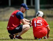 24 July 2021; Cork manager Mark McCarthy speaks with Rachel O'Shea ahead of the All Ireland Intermediate Camogie Championship match between Kildare and Cork at Manguard Plus Kildare GAA Centre of Excellence in Newbridge, Kildare. Photo by Daire Brennan/Sportsfile
