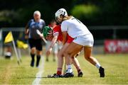 24 July 2021; Fiona Neville of Cork in action against Niamh Hegarty of Kildare during the All Ireland Intermediate Camogie Championship match between Kildare and Cork at Manguard Plus Kildare GAA Centre of Excellence in Newbridge, Kildare. Photo by Daire Brennan/Sportsfile