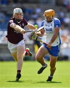 24 July 2021; Billy Power of Waterford is tackled by Shane Cooney of Galway during the GAA Hurling All-Ireland Senior Championship Round 2 match between Waterford and Galway at Semple Stadium in Thurles, Tipperary. Photo by Ray McManus/Sportsfile