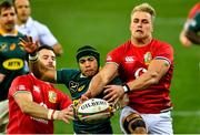 24 July 2021; Cheslin Kolbe of South Africa in action against Duhan van der Merwe, right, and Robbie Henshaw of the British and Irish Lions during the first test of the British and Irish Lions tour match between South Africa and British and Irish Lions at Cape Town Stadium in Cape Town, South Africa. Photo by Ashley Vlotman/Sportsfile