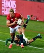 24 July 2021; Duhan van der Merwe of the British and Irish Lions evades the tackle of Willie le Roux of South Africa during the first test of the British and Irish Lions tour match between South Africa and British and Irish Lions at Cape Town Stadium in Cape Town, South Africa. Photo by Ashley Vlotman/Sportsfile