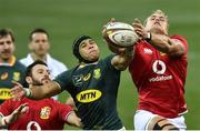 24 July 2021; Duhan van der Merwe, right, and Robbie Henshaw of the British and Irish Lions in action against Cheslin Kolbe of South Africa during the first test of the British and Irish Lions tour match between South Africa and British and Irish Lions at Cape Town Stadium in Cape Town, South Africa. Photo by Ashley Vlotman/Sportsfile
