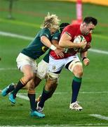 24 July 2021; Jack Conan of the British and Irish Lions is tackled by Cheslin Kolbe and Faf de Klerk of South Africa during the first test of the British and Irish Lions tour match between South Africa and British and Irish Lions at Cape Town Stadium in Cape Town, South Africa. Photo by Ashley Vlotman/Sportsfile