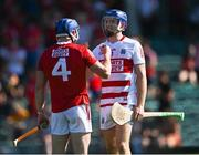 23 July 2021; Cork goalkeeper Patrick Collins and team-mate Niall O'Leary celebrate after his side's victory in the GAA Hurling All-Ireland Senior Championship Round 2 match between Clare and Cork at LIT Gaelic Grounds in Limerick. Photo by Piaras Ó Mídheach/Sportsfile