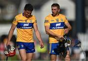 23 July 2021; Clare players John Conlon, left, and David McInerney leave the pitch after their side's defeat in the GAA Hurling All-Ireland Senior Championship Round 2 match between Clare and Cork at LIT Gaelic Grounds in Limerick. Photo by Piaras Ó Mídheach/Sportsfile