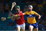 23 July 2021; Séamus Harnedy of Cork is hooked by Diarmuid Ryan of Clare as he prepares to shoot for a first half goal during the GAA Hurling All-Ireland Senior Championship Round 2 match between Clare and Cork at LIT Gaelic Grounds in Limerick. Photo by Piaras Ó Mídheach/Sportsfile