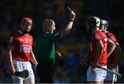 23 July 2021; Referee John Keenan appears to show the black card to Niall O'Leary, not pictured, before showing him a second yellow card, and then a red card, during the GAA Hurling All-Ireland Senior Championship Round 2 match between Clare and Cork at LIT Gaelic Grounds in Limerick. Photo by Piaras Ó Mídheach/Sportsfile