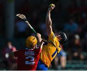 23 July 2021; Tony Kelly of Clare catches the ball over Niall O'Leary of Cork during the GAA Hurling All-Ireland Senior Championship Round 2 match between Clare and Cork at LIT Gaelic Grounds in Limerick. Photo by Piaras Ó Mídheach/Sportsfile