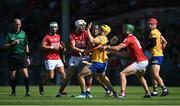 23 July 2021; Rory Hayes of Clare is tackled by Cork players Tim O'Mahony, left, and Séamus Harnedy during the GAA Hurling All-Ireland Senior Championship Round 2 match between Clare and Cork at LIT Gaelic Grounds in Limerick. Photo by Piaras Ó Mídheach/Sportsfile