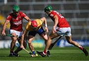 23 July 2021; Paul Flanagan in action against Robbie O'Flynn, left, and Alan Cadogan of Cork during the GAA Hurling All-Ireland Senior Championship Round 2 match between Clare and Cork at LIT Gaelic Grounds in Limerick. Photo by Piaras Ó Mídheach/Sportsfile