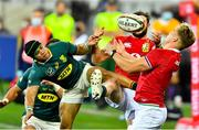 24 July 2021; Robbie Henshaw, hidden, and Duhan van der Merwe, right, of British and Irish Lions in action against Cheslin Kolbe of South Africa during the first test of the British and Irish Lions tour match between South Africa and British and Irish Lions at Cape Town Stadium in Cape Town, South Africa. Photo by Ashley Vlotman/Sportsfile