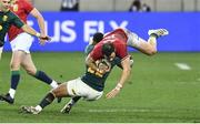 24 July 2021; Robbie Henshaw of the British and Irish Lions is  tackled by Elton Jantjies of South Africa during the first test of the British and Irish Lions tour match between South Africa and British and Irish Lions at Cape Town Stadium in Cape Town, South Africa. Photo by Ashley Vlotman/Sportsfile