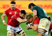24 July 2021; Duhan van der Merwe, centre, is helped by team-mates Ali Price, left, and Jack Conan of British and Irish Lions after being tackled by Eben Etzebeth of South Africa during the first test of the British and Irish Lions tour match between South Africa and British and Irish Lions at Cape Town Stadium in Cape Town, South Africa. Photo by Ashley Vlotman/Sportsfile