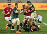 24 July 2021; Jack Conan comes to the assistance of his team-mate Duhan van der Merwe of British and Irish Lions after he is tackled by Eben Etzebeth of South Africa his during the first test of the British and Irish Lions tour match between South Africa and British and Irish Lions at Cape Town Stadium in Cape Town, South Africa. Photo by Ashley Vlotman/Sportsfile
