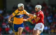 23 July 2021; Conor Cleary of Clare is tackled by Patrick Horgan of Cork during the GAA Hurling All-Ireland Senior Championship Round 2 match between Clare and Cork at LIT Gaelic Grounds in Limerick. Photo by Eóin Noonan/Sportsfile